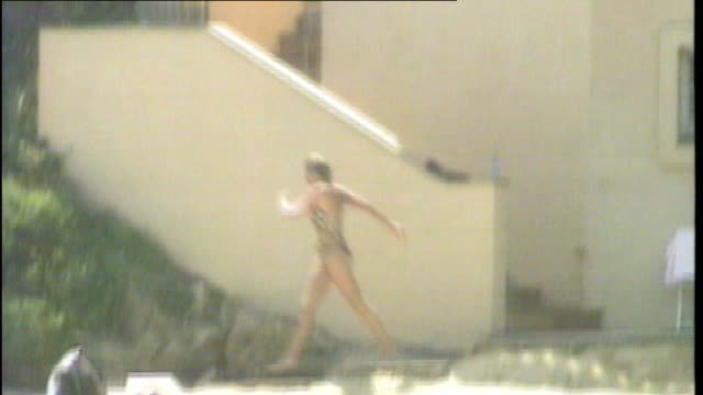 stockvideo's en b-roll-footage met australian magazine publishes duke and duchess of cambridge honeymoon photographs tx st tropez diana princess of wales down stairs and onto beach and... - prinses