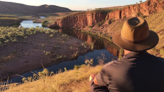 australian man looking at landscape view of kimberley western australia - wilderness stock videos & royalty-free footage
