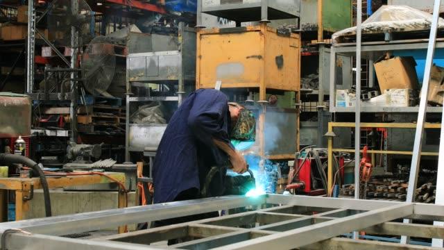 australian metal worker welding in factory - real life stock videos & royalty-free footage