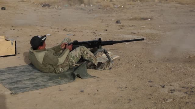 Australian military trainers and members of the Qwat Khasa Iraqi army fire 50caliber machine guns at the Besmaya Range Complex Iraq The training is...