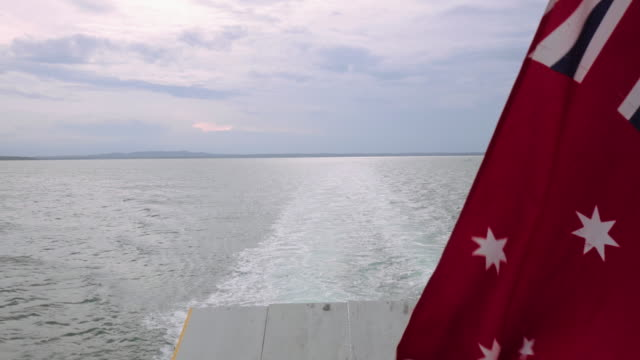 Australian nautical flag in a big ship towards to Stradbroke Island