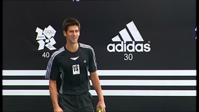 Preview of men's singles final between Murray and Djokovic T21060813 ENGLAND London Tennis player Novak Djokovic hitting balls at publicity event