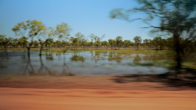 """pov australian outback landscapes from car - """"bbc universal"""" stock videos & royalty-free footage"""