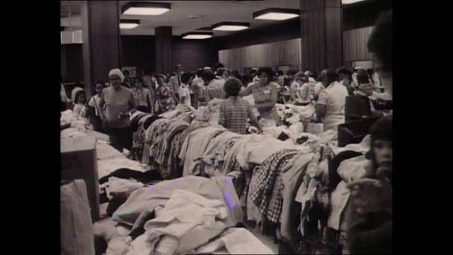 Australian Prime Minister Gough Whitlam and Deputy Minister Jim Cairns meeting Aboriginal women and children and others at welfare clothing...