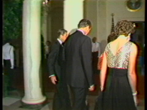 australian prime minister malcolm fraser arrives at the state dinner thrown in his honor with him are his wife as well as the president of the united... - dinner lady stock videos & royalty-free footage
