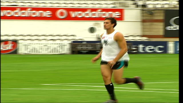 AFL Challenge Trophy ENGLAND London The Oval EXT Members of Port Adelaide Power Australian Rules team training on pitch