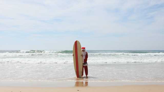 Australian Surfing Santa Celebrating Summer Christmas at the Beach