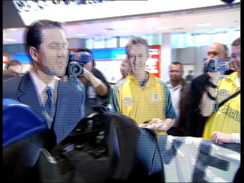 australian team arrive in england/ england win test against bangladesh england london heathrow airport australian cricketers along through airport... - test cricket stock videos & royalty-free footage