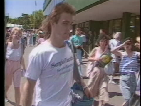 australian tennis player pat cash approaches the entrance to wimbledon with his girlfriend and their son. - sport stock videos & royalty-free footage