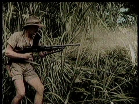 Australian troops launch mortars / a troop fires a machine gun in the jungle / a troop fires a machine gun from an emplacement / a hut explodes /...