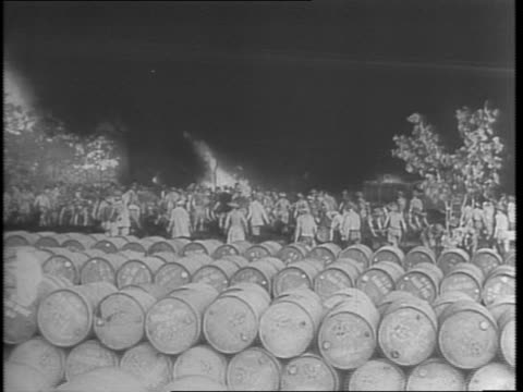vídeos de stock, filmes e b-roll de australian troops rescue fuel stores bombed by japanese / after p38s knock down attacking japanese giant transport fly in more gas to help win battle... - emoção negativa