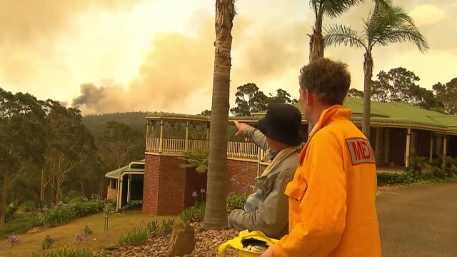 fires raging in every australian state, with 23 dead and over a thousand homes destroyed; australia: new south wales: batemans bay: ext smoke from... - australia stock videos & royalty-free footage