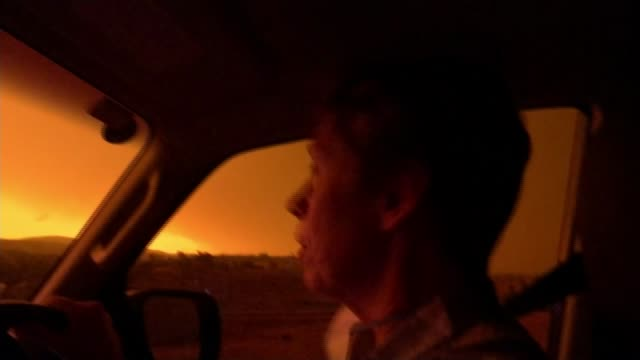 fires raging in every australian state, with 23 dead and over a thousand homes destroyed; australia: int car close shot of car dashboard with on... - destruction stock videos & royalty-free footage