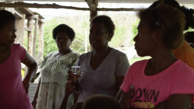 vanuatu - march 31, 2015: australian woman demonstrates water filtration system surrounded by group of locals - homeless shelter stock videos & royalty-free footage