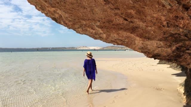 australian woman walking on coral bay western australia - western australia bildbanksvideor och videomaterial från bakom kulisserna