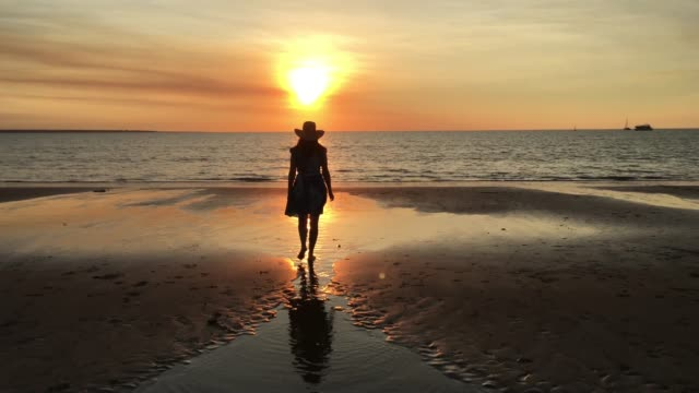 australian woman walking on mindil beach at sunset in darwin northern territory of australia - sunset stock videos & royalty-free footage