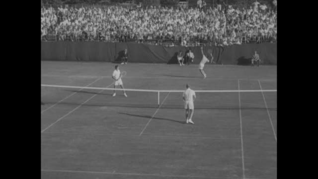 australians lew hoad and ken rosewall, in near court, play americans tony trabert and vic seixas, in rear court, at the davis cup men's doubles... - davis cup stock videos & royalty-free footage