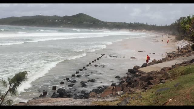 australia's byron bay usually conjures images of bathers lounging on sunkissed shores, or blissed-out longboarders cruising along cyan-blue waves --... - vagare senza meta video stock e b–roll