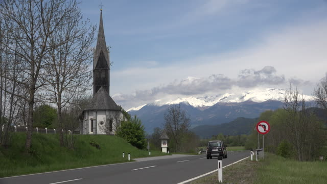 Austria cars and motorcycle on highway by church near Kamering