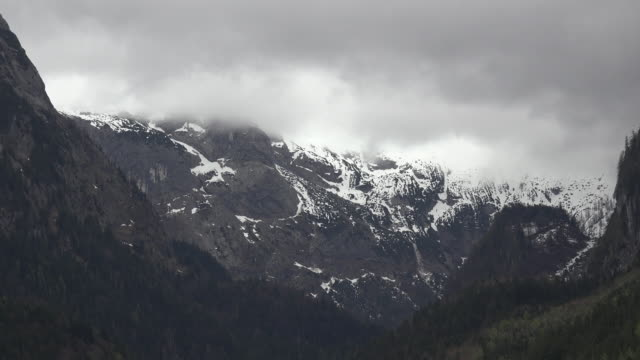 austria dachstein partly covered with gloomy clouds - dachstein mountains stock videos and b-roll footage