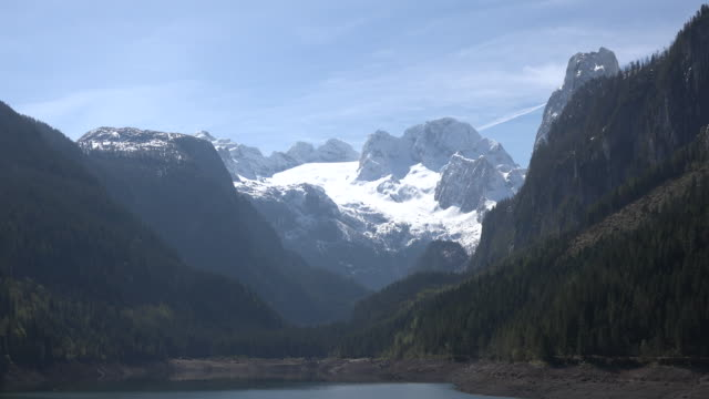 austria dachstein zooms out from glacier - アッパーオーストリア点の映像素材/bロール