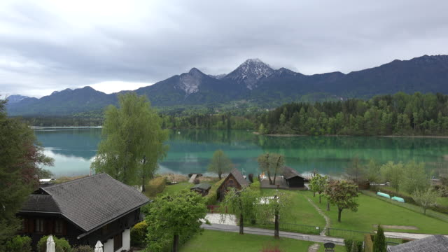 austria faaker see colorful water zoom in - carinthia stock videos & royalty-free footage