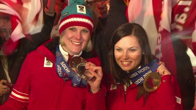 austrian alpine skier anna fenninger celebrates claiming olympic gold in the women's super g with fellow compatriot nicole hosp who took bronze clean... - assertiveness stock videos & royalty-free footage