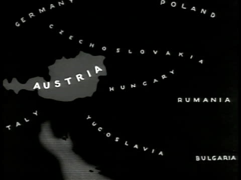 vídeos de stock, filmes e b-roll de austrian coat of arms map austria ha ws austrian parliament building occupied vienna nazi german troops parade on street people lining roadway nazi... - cultura austríaca