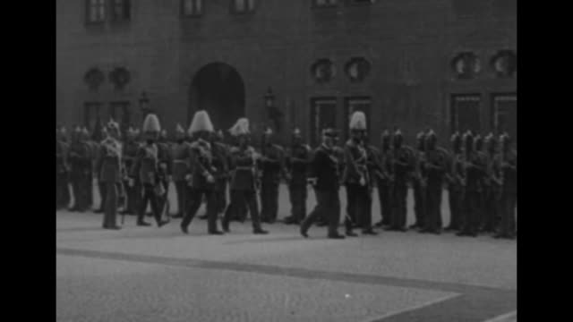 austrian emperor franz joseph i, accompanied by officers in dress uniforms, walks along double line of soldiers in uniforms and pickelhaube helmets /... - austria video stock e b–roll
