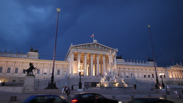 ws austrian parliament building during storm at dusk / vienna, austria - traditionally austrian stock videos & royalty-free footage