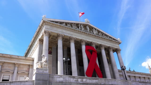 austrian parliament with red ribbon - aids awareness ribbon stock videos & royalty-free footage