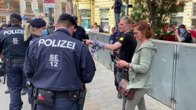 austrian police wearing face masks checks identitie of participants during a demonstration against the government measures to slow down the spread of... - traditionally austrian stock videos & royalty-free footage