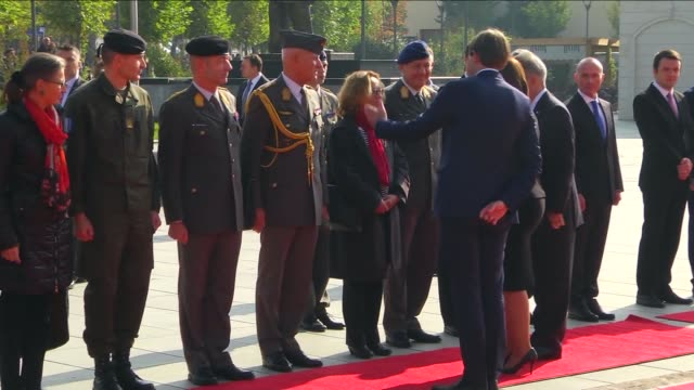 Austrian President Heinz Fischer walks past guard of honor after being welcomed by the Kosovo's President Atifete Jahjaga at the Ibrahim Rugova...