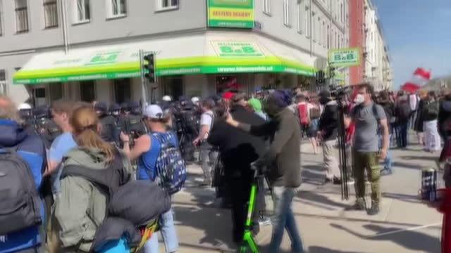 austrian protesters, who opposing the coronavirus restrictions, clashed with police in capital vienna on saturday. security forces used tear gas... - traditionally austrian stock videos & royalty-free footage