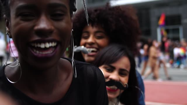 authentic group of diverse friends having fun - moustache stock videos & royalty-free footage