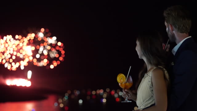 authentic wealth - couple evening fireworks - dressing up stock videos & royalty-free footage