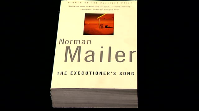 author and writer norman mailer dies; cover of norman mailer's novel 'the executioner's song' - executioner stock videos & royalty-free footage
