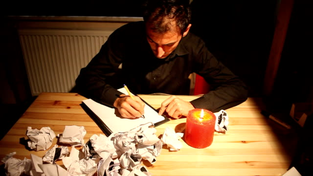 author tries to write but he is unsuccessfull - crumpled paper stock videos and b-roll footage