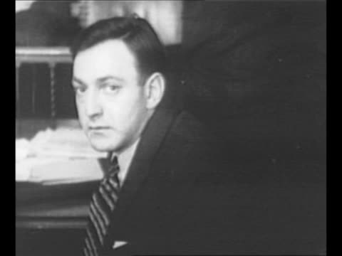 Authorities arrest gangster Dutch Schultz in New York City Schultz handcuffed to an agent walks with handkerchief covering his face as the group...