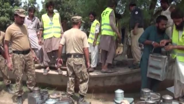 authorities blast holes in a strategic dyke to divert the turbid brown floodwaters away from multan a city of two million inhabitants and the nerve... - multan stock videos and b-roll footage