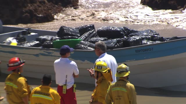 stockvideo's en b-roll-footage met authorities converged on leo carillo state park in malibu on monday after a boat loaded with marijuana washed ashore - goede staat