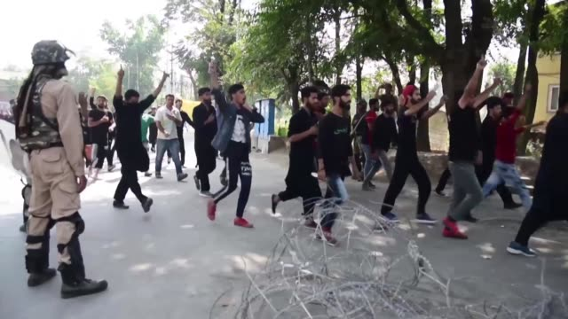 authorities tighten a month long security lockdown in indian kashmir's main city of srinagar after breaking up religious processions by shiite... - jammu e kashmir video stock e b–roll