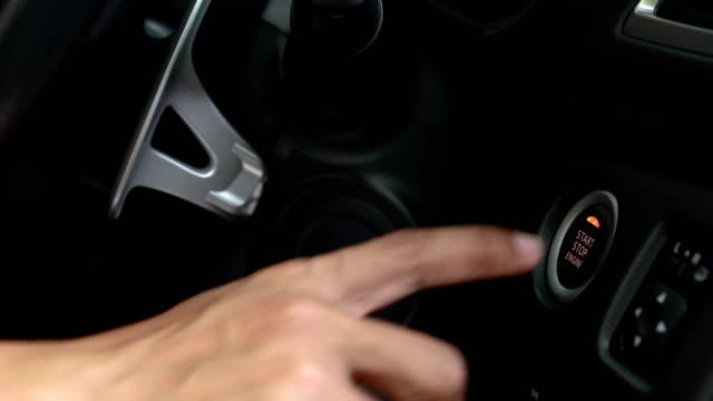 vídeos de stock, filmes e b-roll de botão de arranque de motor de carro de auto para a entrada keyless - ignição