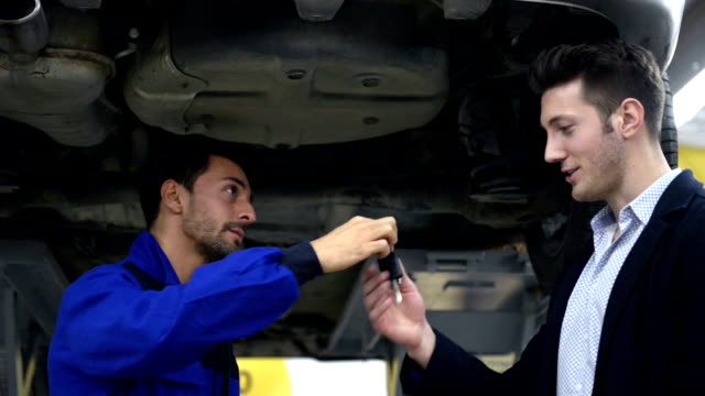 auto mechanic and customer in auto repair shop - repair garage stock videos & royalty-free footage