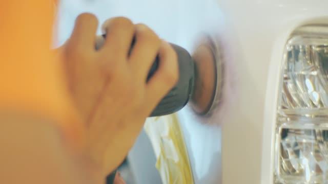 auto mechanic polishing a white new car - polishing stock videos & royalty-free footage