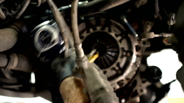 auto mechanic preparing car for removing gearshift - tire vehicle part stock videos and b-roll footage
