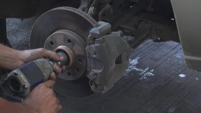 auto mechanic repair disk brake - bolt stock videos & royalty-free footage
