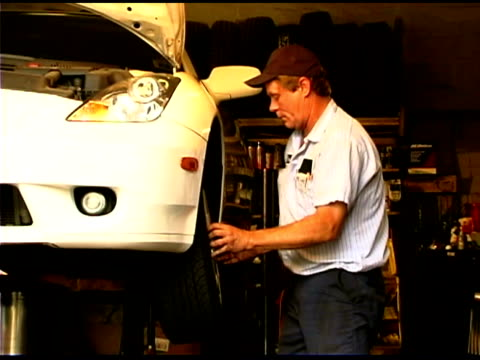 auto mechanic repairing car - one mature man only stock videos & royalty-free footage