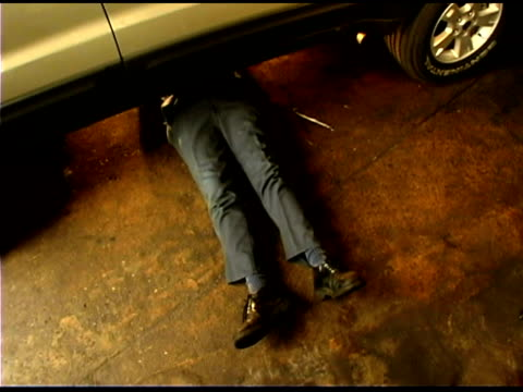 auto mechanic under car - only mature men stock videos & royalty-free footage