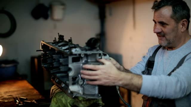Auto mechanic working on a car engine
